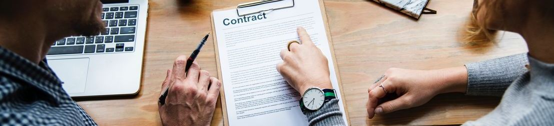 Picture of people looking at contract