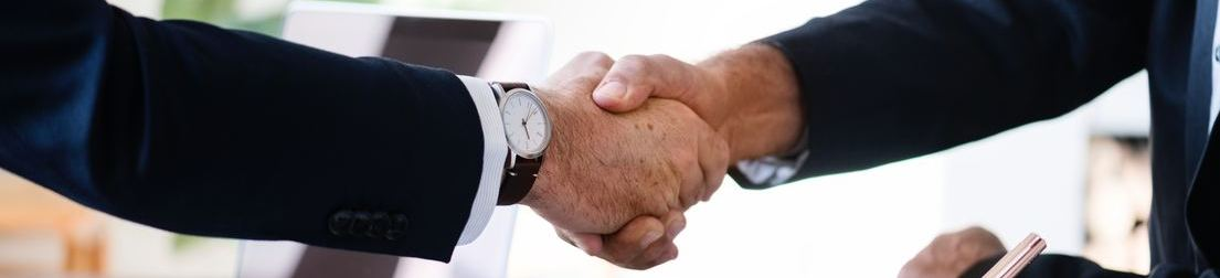 Picture of two people shaking hands