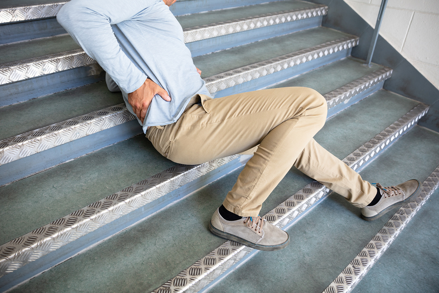 Picture of man slip and fall on stairs